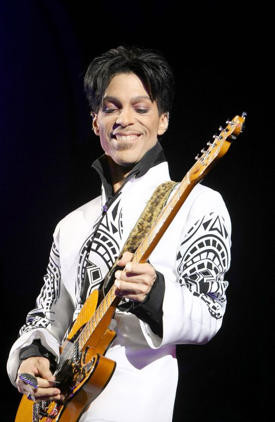 PRINCE: THE UNEXPLAINABLE GENIUS OF MUSIC AND FASHION