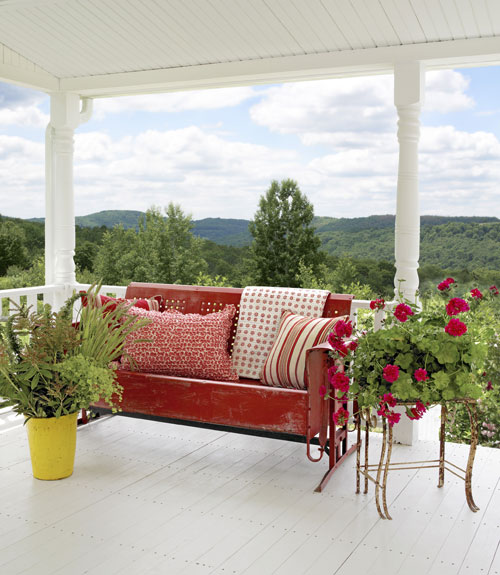 Here S A Covered Porch With Gorgeous Mountain View The Bright Colors Of Red Vintage Glider And Yellow Planter Stand Out Beautifully Against