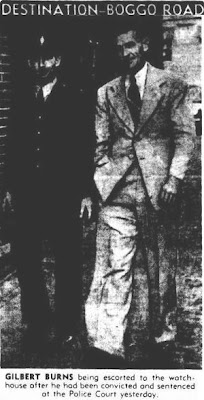 Burns being escorted to the Brisbane watch-house. (Courier-Mail, October 1948).