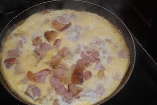 Cooking the best omelette at this time of year, ham, potatoes and egg.