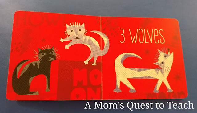 inside page of Dracula board book; 3 wolves