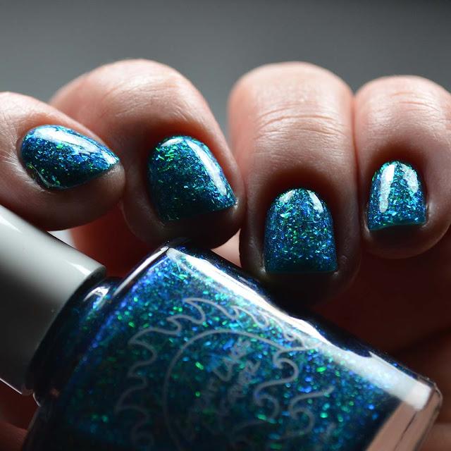 teal flakie nail polish swatch low light