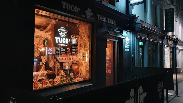 Mexican takeaway in Ireland with halloween decorations in teh front window - pumpkins and skulls