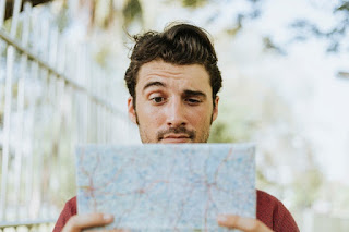 Lost Man Reading A Map