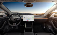 The unexpectedly sleek and button-free dashboard of Tesla's Model 3. (Credit: Tesla) Click to Enlarge.