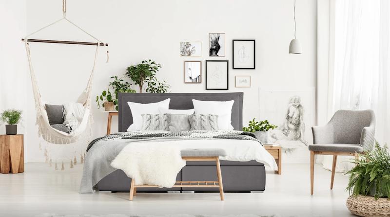 Dormitorio con cama continental moderno