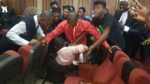 Breaking: Unknown man hits Sowore in the Neck with unknown Substance during Sowore re-arrest in Court room.