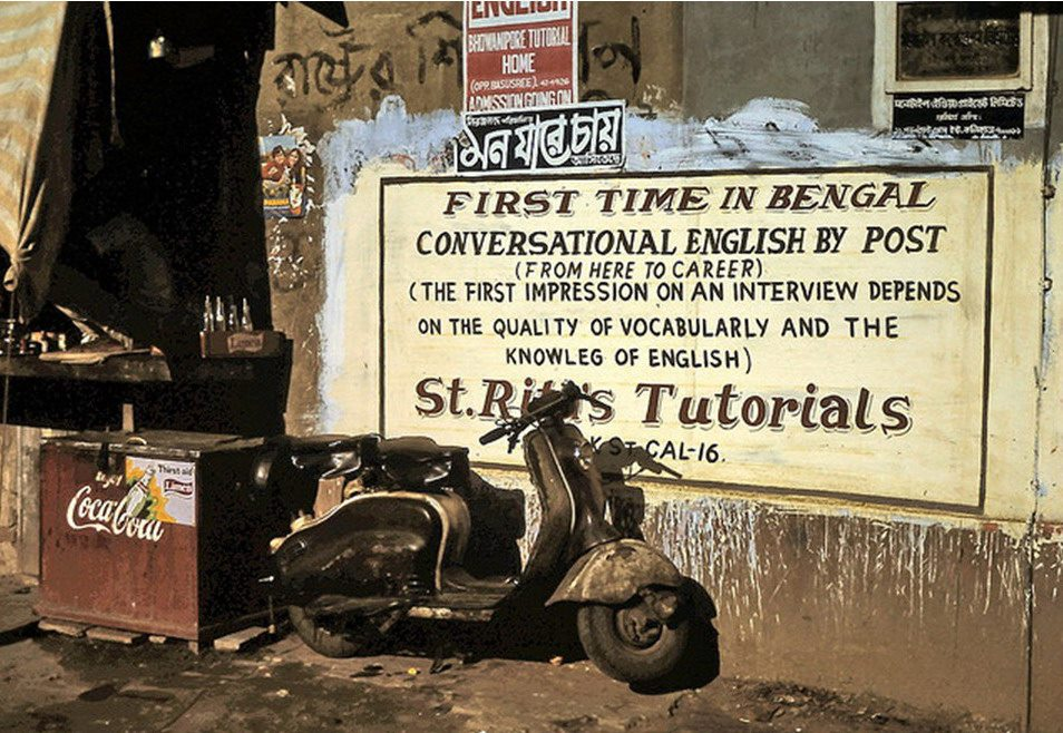 English Learning Advertisement Sign behind of a Scooter