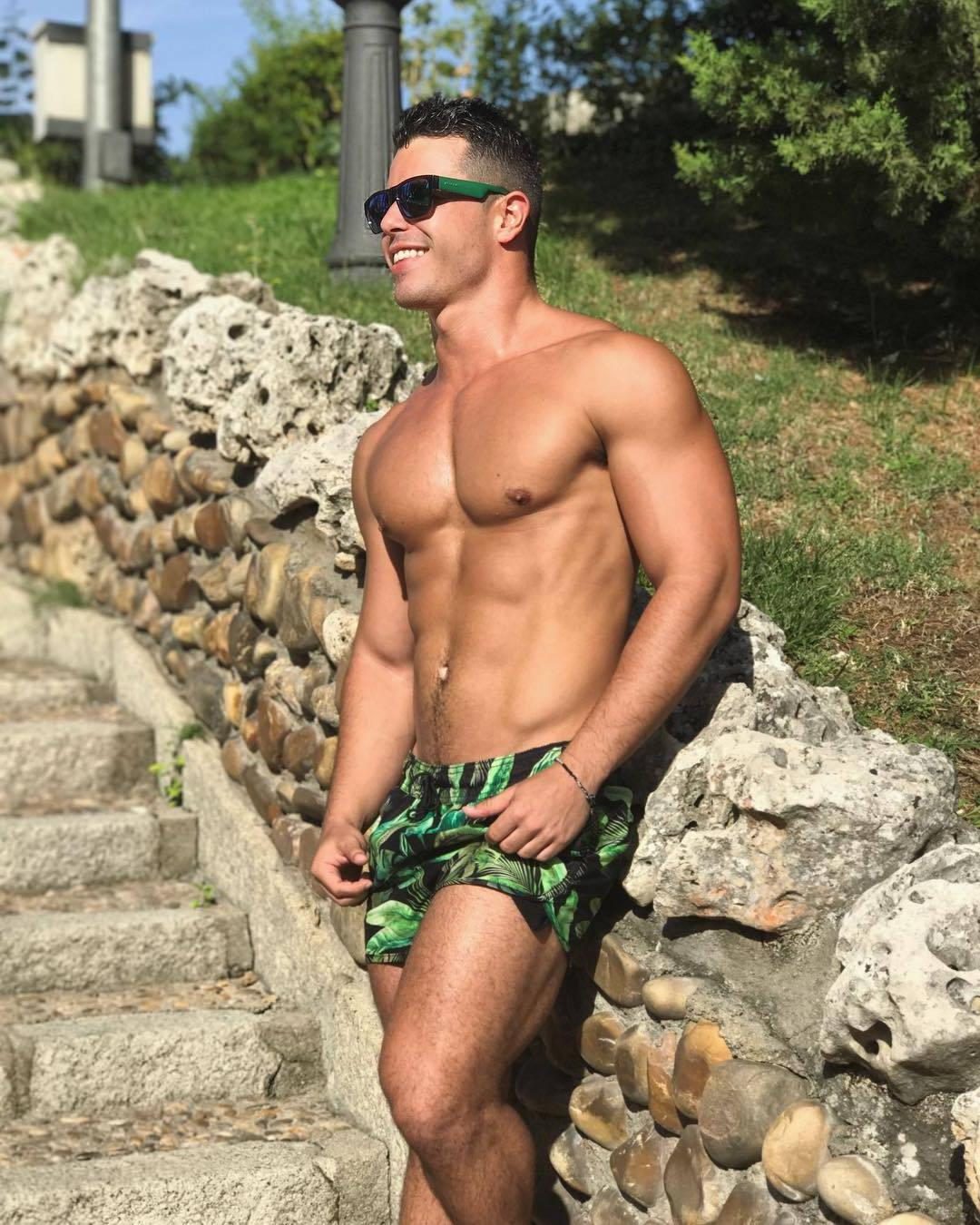 attractive-toned-shirtless-body-fit-brazilian-male-hunk-smiling-outdoors-sunny