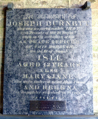 The memorial to John Burnett inside Lostwithiel parish church