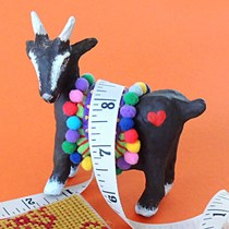 Fred the papier mache goat with a tape measure