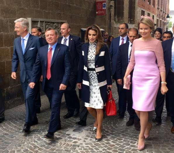 Queen Mathilde and Queen Rania visit Bruges, Belgium. Queen Rania wore Louis Vuitton dress and Louis Vuitton bags. Queen Mathilde wore Natan dress