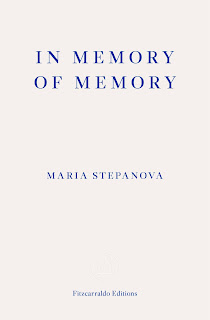 Plain white book cover with title and author name in blue