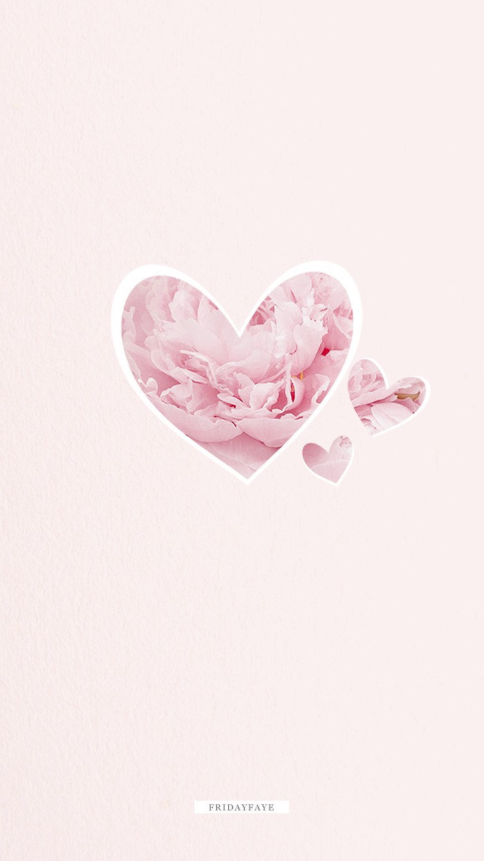 Hearts filled with pink cherry blossom on a pink background