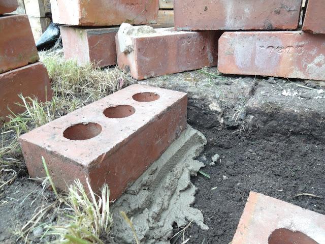building bricks on soil