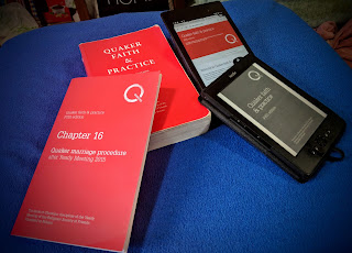 A paper copy of Quaker Faith & Practice (not most recent edition), a paper copy of the update Chapter 16 (Quaker Marriage Procedure), Kindle e-reader showing the Kindle edition of the book, and a tablet showing the web version.