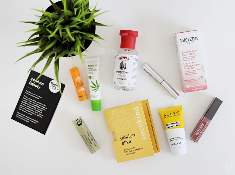 Whole Foods beauty bag contents on a white table