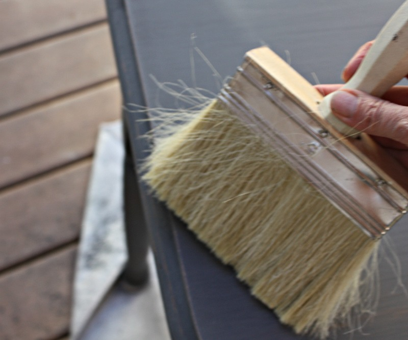 STEP 3: Use a soft brush to gently brush off excess sanding dust.