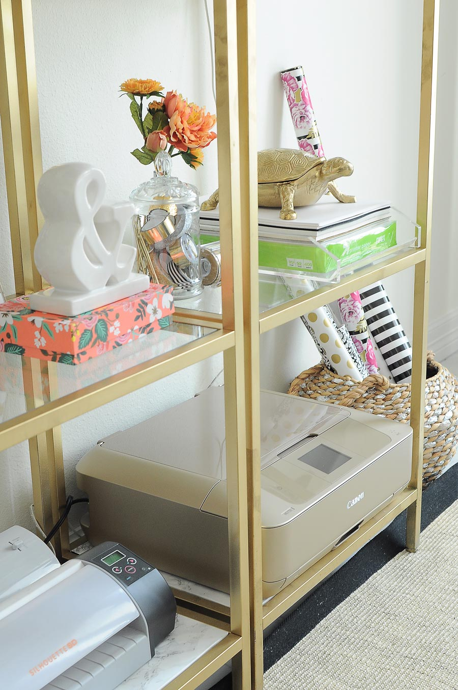 Gold IKEA VITTSJO shelves used in a home office space for craft supplies.