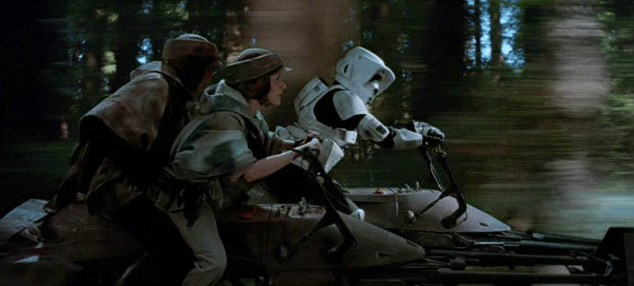 Big screen: Luke Skywalker (Mark Hamill) and Princess Leia (Carrie Fisher) battle a Stormtrooper on their hoverbike in Star Wars Return of the Jedi