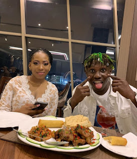 Shy Bolanle Couldn't Glance much at the Camera at a Night party with the Zanku Crooner Zlatan ibile.