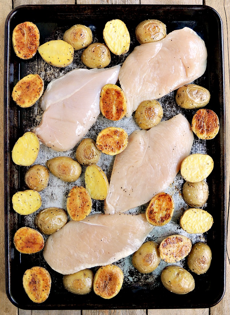Chicken and potatoes on a sheet pan.