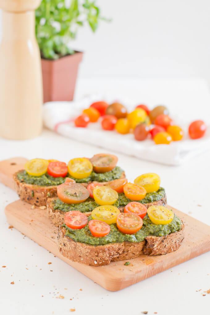 Vegan Pesto Cherry Tomato Bruschetta via danceofstoves.com #vegan