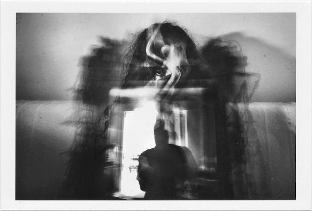dirty photos - a - dark double exposure photo of girl portrait and self reflection on mirror