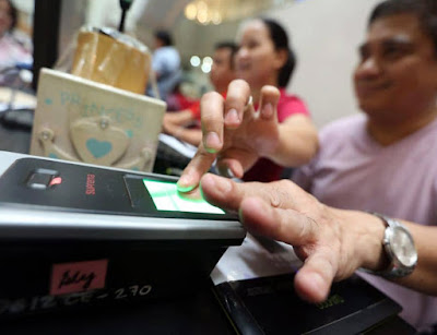Photo of biometric voting equipment