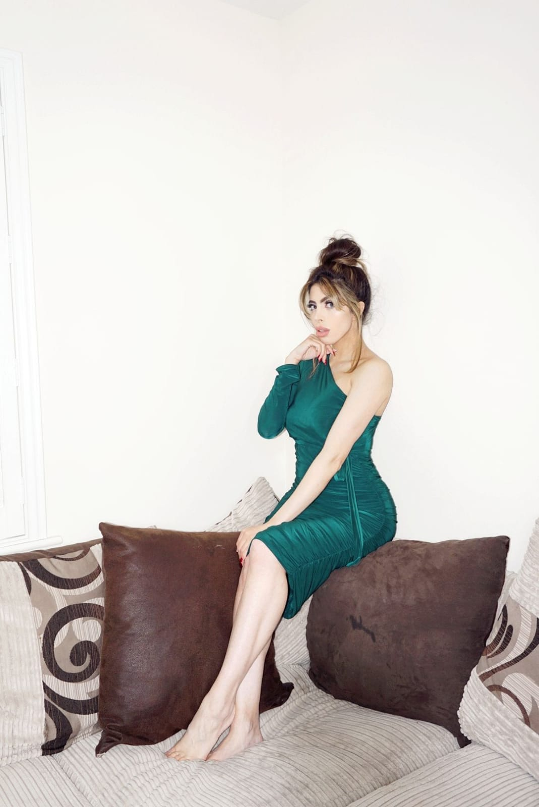 Femme Luxe Emerald One Shoulder Ruched Slinky Midi Dress in model Savannah