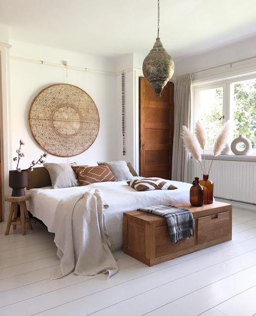 neutral bohemian bedroom with white modern donut vase