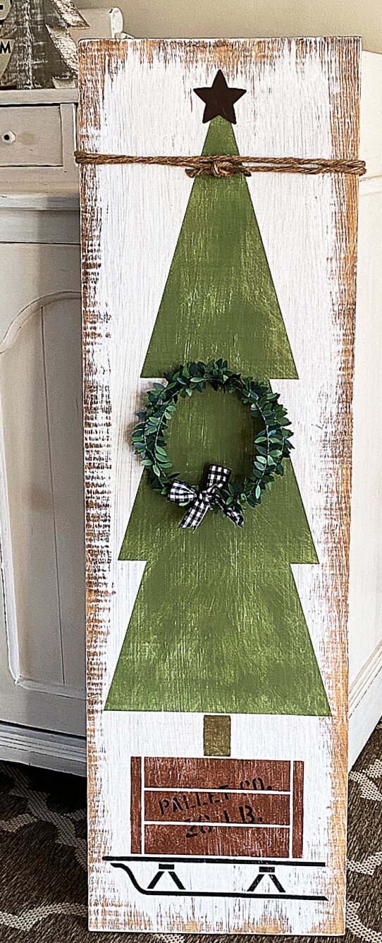 stenciled Christmas tree with a wreath