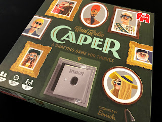 The box for Caper, featuring beautiful artwork from Emrich