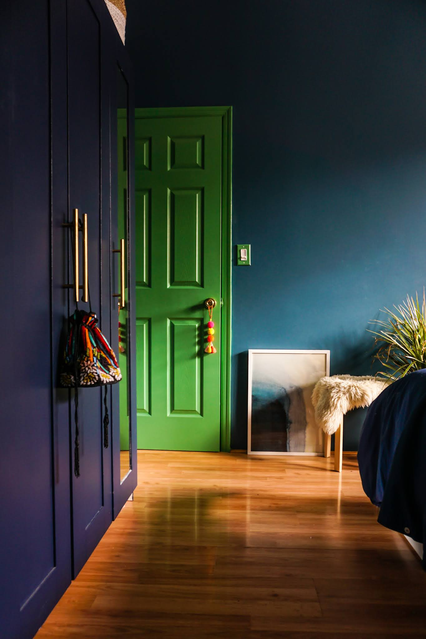green bedroom door // green and blue bedroom // green and aqua bedroom // deep bedroom colors // soothing dark bedroom colors // bedroom color Inspo // color scheme blue and green // Kelly green door // Clare Paint matcha latte // Clare Paint deep dive // Clare Paint goodnight moon // blue bedroom // green bedroom // colorful doors // colorful interiors // colorful interior door // colorful homes // Megan Zietz home // tfdiaries home // green bedroom door // deep blue walls // dark and moody bedrooms // small colorful homes // small space paint colors // colorful home inspiration // contrasting door colors // door color ideas // door color inspo // boho bedrooms // moody bedrooms // jewel tone bedrooms //