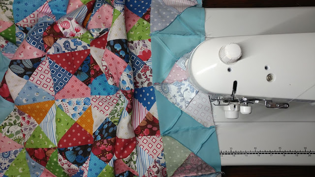 Piecing the Exploding Heart quilt