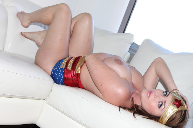 Sophie Dee sexy wonder woman naked boobs lying on sofa