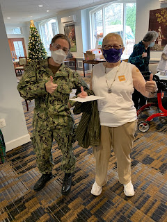 LCDR Gilbert with a Knollwood resident who just received her vaccine.