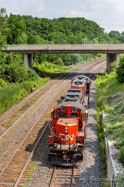 CN 4131 brings up the rear of a light-engine movement.