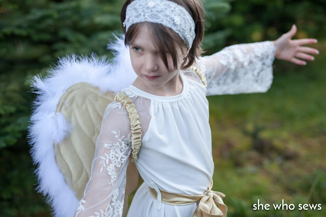Girl in white lace dress with wings