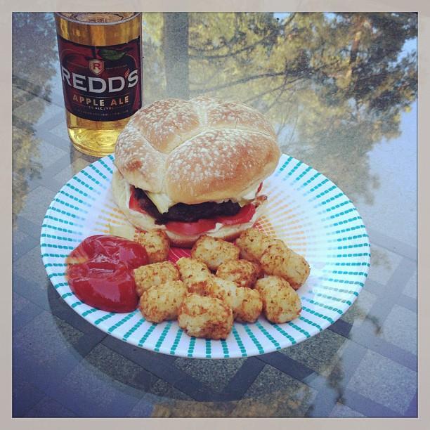 hamburger, tots, redd's apple ale