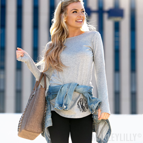 girl wearing monogrammed tunic top