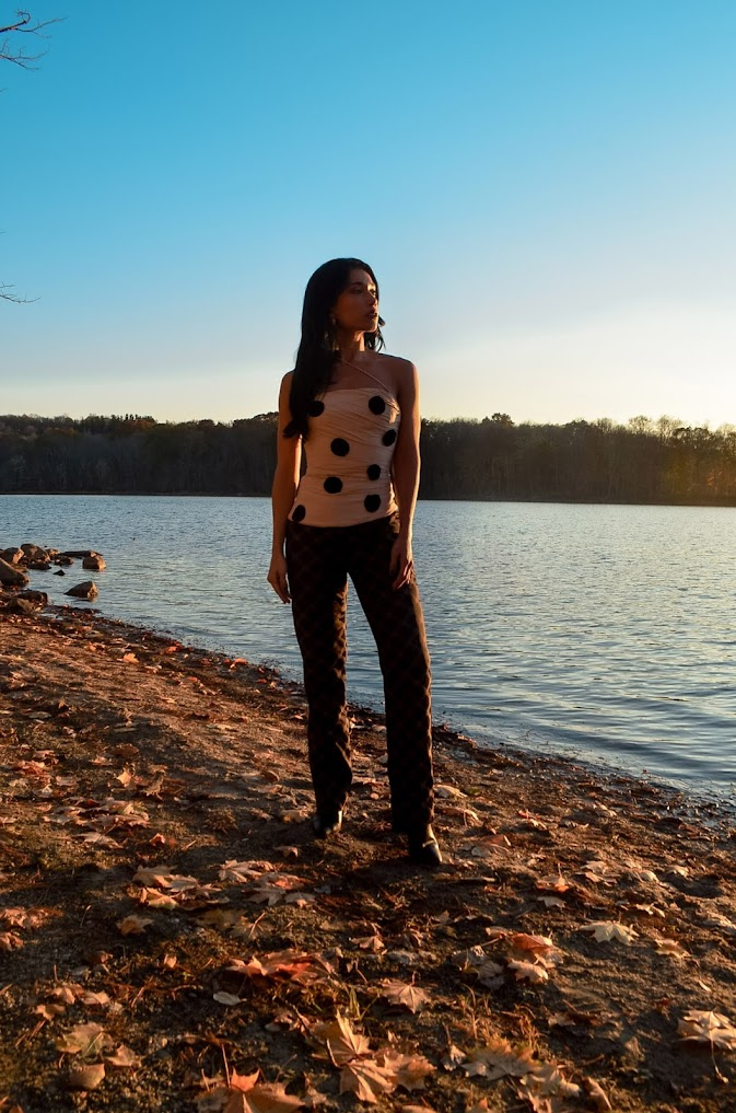 Beautiful blue lake and sky in Upstate NY, outfit fall, Versace logo pants, brown beige medusa logo, Jacquemus polka dot top strapple top, beige top with black dots, trees and leaves and a lake in the background, fall mood, North Salem, NY 2020