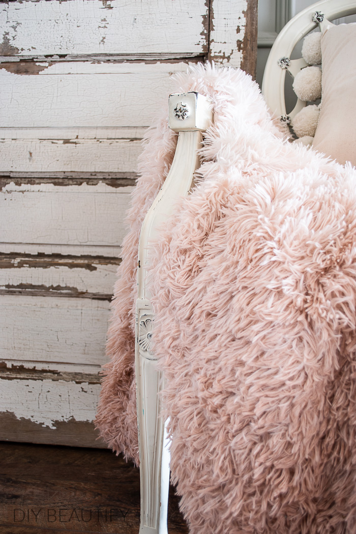 chippy door and fluffy pink throw