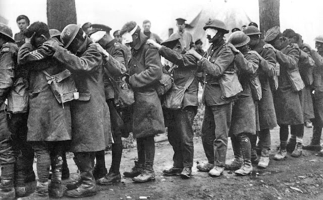 WWI British 55th Division. Line of injured soldiers. The result of chemical warfare 1918.  Impossible Wars. marchmatron.com