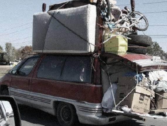 vanholio van overloaded with stuff on top, sagging down the back shocks