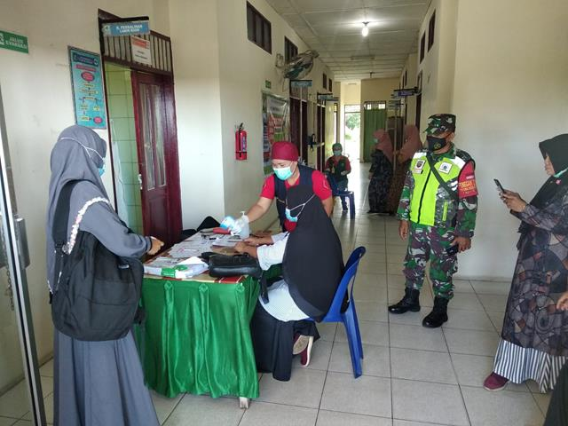 Tepatnya Dipuskesmas Diwilayah Binaan, Personel Jajaran Kodim 0207/Simalungun Laksanakan Pengecekan Data Warga