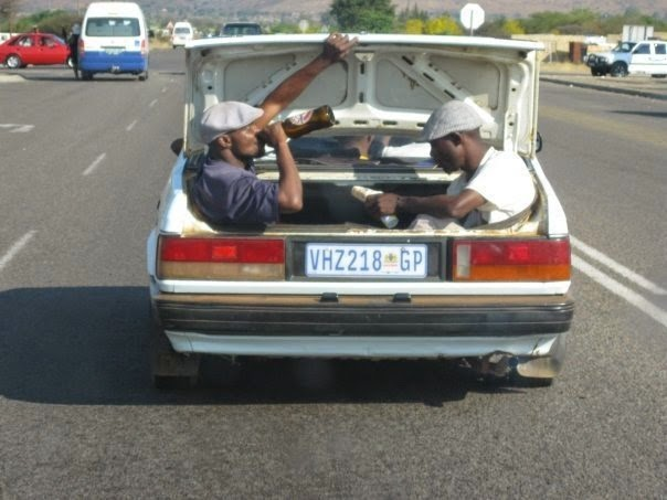 Funny men drinking beer boot car picture