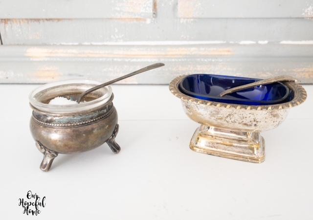 two silver salt cellars spoons