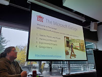 Picture of Stacey Mulcahy and a screen describing the Microsoft Garage as a place where Microsoft employees can hack, make, and experiment.