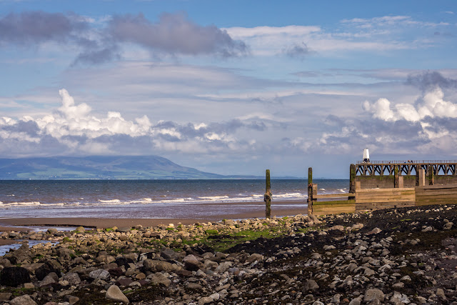 Photo of Maryport pier with the Scottish hills in the distance